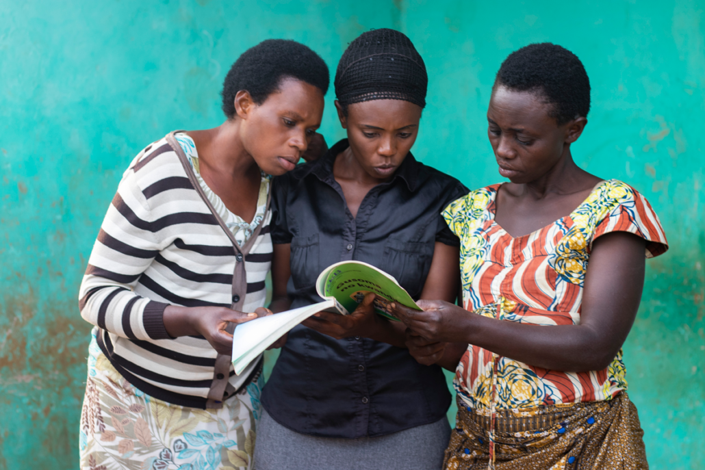 Adult Literacy Grads read together